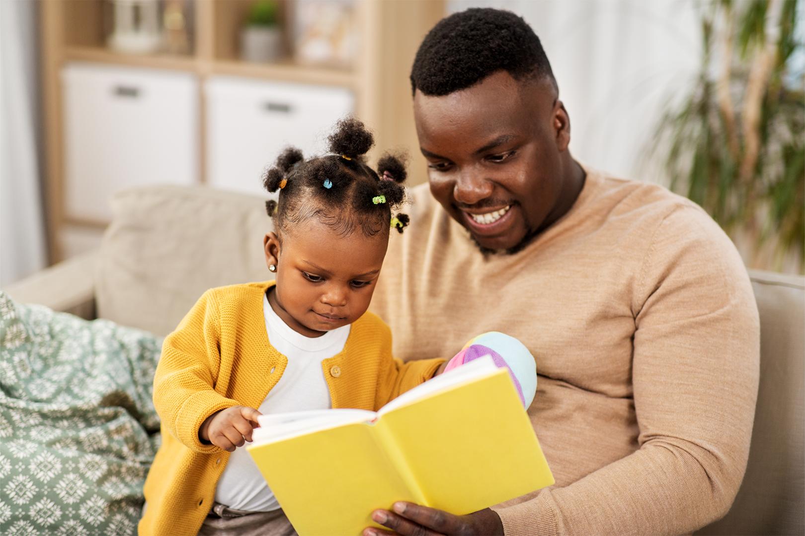 Man reading to daughter